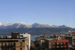 North Shore Mountains with first snow. From dowtown Vancouver Royalty Free Stock Photo