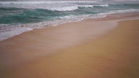 North Shore Oahu Hawaii Bonsai Pipeline Pacific Ocean United States. The sea rushes up meeting the sand on Oahu Island in the Pacific Ocean of North America stock footage
