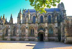 The north side of Rosslyn Chapel. N showing the main door into the church.  One this side the heavy solid buttresses support the lower level walls and more stock images