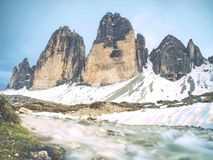 North side of Sexten Dolomites symbol. May view from popular trail around the rocks. North side of Sexten Dolomites symbol - Tre Cime. May view from popular stock image