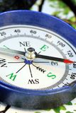 North, South, East and West. Closeup of a blue compass for navigational purpose or to show direction stock images