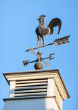 North, South, East or West. Old metal weathervane on the pillar of a building stock images