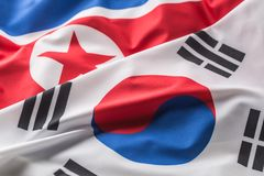 North and south korea flag. Colorful south and North Korea flag. Waving in the wind stock photo