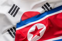 North and south korea flag. Colorful south and North Korea flag. Waving in the wind royalty free stock image