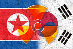 North and south korea flag with radiation symbol background Stock Photo