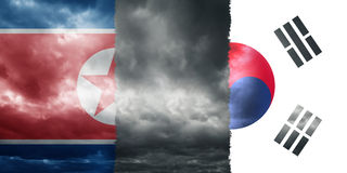 North and South Korea flags with cludscape texture Stock Photos