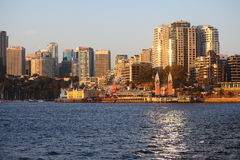 North Sydney skyline with Luna Park at sunset. Skyline of North Sydney, Australia, with Luna Park at Milsons Point in Lavender Bay Stock Photos