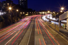 North Sydney Traffic. North Sydney, NSW, Australia - July 27th, 2015.   Warringah Freeway, Sydney Harbour Tunnel and the Cahill Expressway merging together going Royalty Free Stock Photos