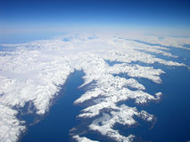 North to Alaska. Aerial view of the Alaskan coastline, complete with fjiords royalty free stock image
