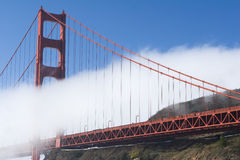 North Tower. A strip of fog floats by the north tower of the Golden Gate Bridge Royalty Free Stock Image