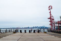 NORTH VANCOUVER, BC, CANADA - JUNE 9, 2019: The boardwalk area near the shipyards at Lonsdale Quay public market. stock photography