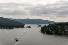 NORTH VANCOUVER, CANADA - May 21, 2018: View of Indian Arm with Yachts in Deep Cove.  royalty free stock images
