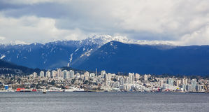 City Overlooked by Snowy Mountains Stock Image