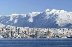 North Vancouver Skyline. This image was taken In Vancouver, Canada's Stanly Park after a snowfall Stock Images