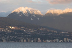 North Vancouver with snow capped North Shore mountains Royalty Free Stock Photos