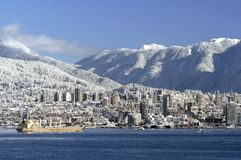 North Vancouver Winter Skyline. This image was taken In Vancouver, Canada's Stanly Park during a snowfall. The image was captured with a Nikon D200 Stock Photography