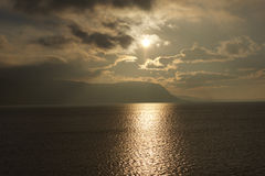 North Wales Sunset. Bronze sunset where the welsh mountains meet the Irish Sea on the North Wales coast Stock Photos