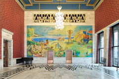 North wall of Banquet Hall in Oslo City Hall, Norway. With fresco of beach life along the fjord. The fresco was painted by the Norwegian artist Willi Midelfart Stock Images