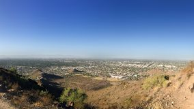 North-West Phoenix, AZ. North-West part of Phoenix Metro between Central Avenue and Peoria Road as seen from the top of North Mountain Park hiking trails stock photo