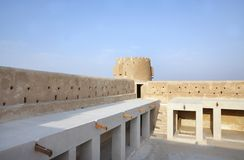 North western galleries inside Zubarah fort, Qatar. The Zubarah Fort built in 1938 follows a traditional concept with a square ground plan with towers at the Royalty Free Stock Images