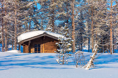 North Winter forest Landscape with wooden lodge Stock Photo