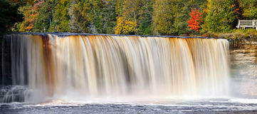 North Woods Waterfall. Tahquamenon Falls in Michigan's eastern Upper Peninsula is seen in panoramic fashion with colorful fall foliage. This beautiful waterfall Royalty Free Stock Image