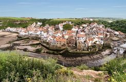 The North Yorkshire coastal village of Staithes, viewed from Cow. Bar Nab stock photos