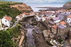 The North Yorkshire coastal villages of Staithes right hand sid. Eand Cowbar left hand side royalty free stock photography