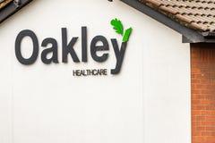 Northampton 5 de enero de 2018 BRITÁNICO: Muestra del logotipo de Oakley Healthcare Imágenes de archivo libres de regalías