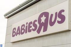 Northampton, Regno Unito - 26 ottobre 2017: Vista del logo di BabiesRus in Nene Valley Retail Park Immagine Stock Libera da Diritti