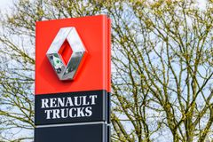 Northampton, UK - Apr 21, 2018:: Day view official Renault Trucks dealership sign over blue sky. Renault is a French. Multinational automotive manufacturer Stock Photos