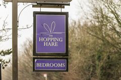 Northampton UK January 11 2018: The Hopping Hare Hotel Bar Restaurant logo sign stand Royalty Free Stock Photos