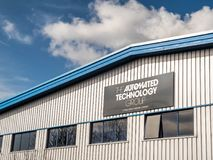 Northampton UK March 16 2018: The Automated Technology Group A Wood Group Mustang Company logo banner on warehouse wall. In Moulton Industrial Estate Stock Photo