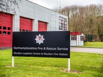 Northampton UK March 16 2018: Northamptonshire Fire and Rescue Service sign over modern English fire station.  Royalty Free Stock Photography
