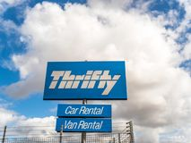 Northampton UK March 16 2018: Thrifty Car Van Rentals logo sign stand.  Stock Photography