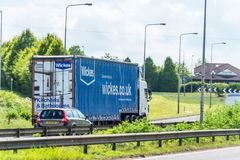 Northampton, UK - May 10th 2019: wickes curtain side truck on uk motorway in fast motion royalty free stock photography