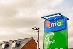 Northampton UK October 3, 2017: IMO Attended car wash logo sign in Northampton town centre.  Stock Photos