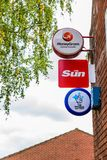 Northampton UK October 3, 2017: Moneygram The Sun National Lottery and Post Office logo sign stand Northampton.  Royalty Free Stock Photography
