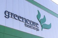 Northampton UK Oktober 3, 2017: Tecken för logo för Greencore matgrupp på fabriksväggen Northampton Royaltyfria Bilder