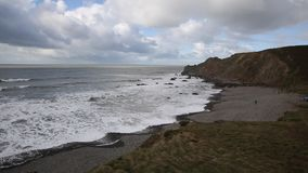 Northcott Mouth beach north of Bude North Cornwall England UK south west cast path with waves pan stock video