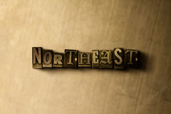 NORTHEAST - close-up of grungy vintage typeset word on metal backdrop. Royalty free stock illustration.  Can be used for online banner ads and direct mail Stock Photography