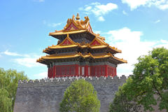 Northeast corner tower of The Forbidden City, Beijing, China. Highly decorated multi-layered magnificent roof of the northeast corner tower in Forbidden City Royalty Free Stock Photos