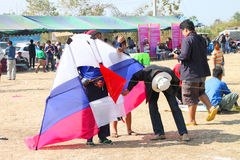 Northeast Kites Festival season. HUAI RAT, BURIRAM - DECEMBER 18 : The unidentified Thai men are preparing their kite to contest in kites festival season on royalty free stock photo