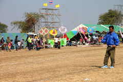Northeast Kites Festival Season. HUAI RAT, BURIRAM - DECEMBER 18 : The unidentified Thai man is playing kite in northeast kites festival season on December 18 royalty free stock photo