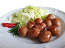 Northeastern of Thailand Sausage. Made from rice and minced pork and garlic seasoned with salt. Wrapped with pork fillet royalty free stock image