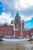 Northen harbour and Uspensky Cathedral. Helsinki, Finland. Sailing Ship, Warehouse Building and Uspensky Orthodox Cathedral in North Harbour. Helsinki, Finland Royalty Free Stock Image