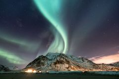 Northen light adove mountains. Beautiful natural landscape in the Norway Stock Image
