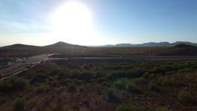 Northern Arizona highway traffic aerial pan stock video