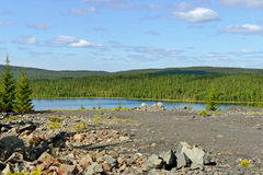 Northern blue Lake near old abandoned mine Stock Image
