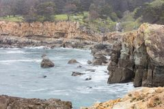 Northern California Rocky Coastline in Sonoma. The cold waters of the Pacific Ocean wash against the rocky northern California coastline in Sonoma. This scenic stock photography